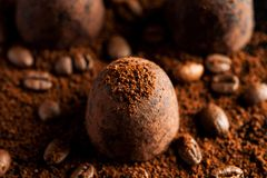 Chocolate sweets with ground coffee and coffee beans.  royalty free stock photos