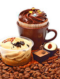 Chocolate sweets, muffins and coffee beans Royalty Free Stock Photos