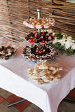 Chocolate sweets and pastry served on layered plates Royalty Free Stock Images