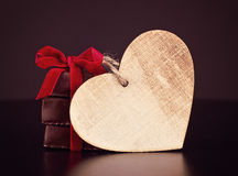 Chocolate sweets with red ribbon and wooden Valentine`s heart for St. Valentine`s day Stock Images