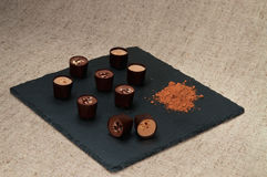 Chocolate sweets on the slate plate. Royalty Free Stock Photography