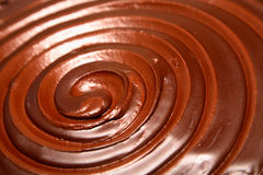 Chocolate swirl. Detail of a swirl in chocolate icing on top of a rich chocolate cake Royalty Free Stock Image