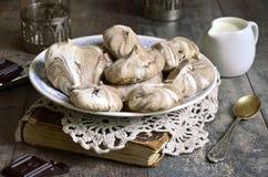 Chocolate swirl meringues. Royalty Free Stock Photos