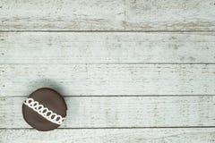 Chocolate swirled decorated cupcake on wood background stock photo