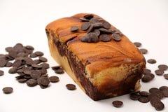 Chocolate swirls on a marble cake Royalty Free Stock Photo