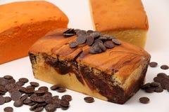 Chocolate swirls on a marble cake Stock Photo