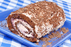 Chocolate swiss roll cake Stock Photos