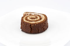 Chocolate Swiss roll closeup Stock Images