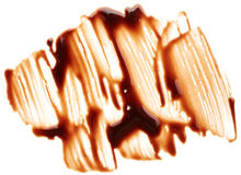 Chocolate syrup Stock Images