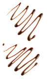 Chocolate syrup isolated on white with clipping Royalty Free Stock Image