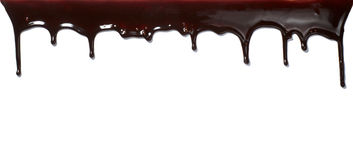 Chocolate syrup leaking liquid sweet food Stock Image
