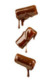 Chocolate syrup pouring over Stock Photo