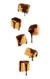 Chocolate syrup pouring over a sweet wafer Royalty Free Stock Photo