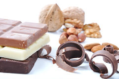 Chocolate, table, pieces. On white background Royalty Free Stock Photos