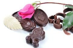 Chocolate, table, pieces. On white background Royalty Free Stock Photography