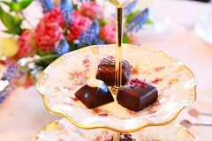 Chocolate on the table. Scenery of the chocolate of the table and the displayed flower Royalty Free Stock Images