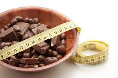 Chocolate with tape measure Royalty Free Stock Images