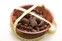 Chocolate with tape measure Stock Photo