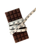 Chocolate and tape measure Royalty Free Stock Images