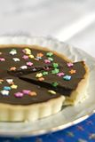 Chocolate Tart. Detail of a Chocolate Tart with colorful star candies Royalty Free Stock Image
