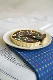 Chocolate Tart. With Colorful Star Candies Royalty Free Stock Photos