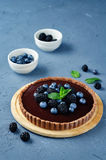 Chocolate tart with blackberries and blueberries Royalty Free Stock Photo