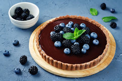 Chocolate tart with blackberries and blueberries Royalty Free Stock Image