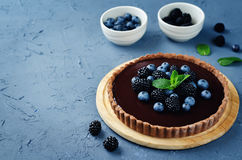 Chocolate tart with blackberries and blueberries Stock Photo