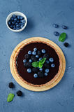 Chocolate tart with blackberries and blueberries Stock Image