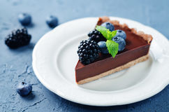 Chocolate tart with blackberries and blueberries Stock Photography