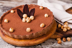 Chocolate tart with hazelnuts Stock Photography