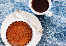 Chocolate tart, lace and espresso Royalty Free Stock Images