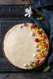 Chocolate tart with mango and raspberries Royalty Free Stock Image