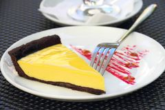 Chocolate tart with milk and lemon cream Stock Image