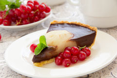 Chocolate tart with pears. Royalty Free Stock Image