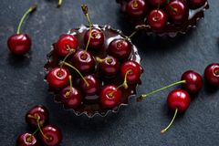 Chocolate tart with red cherry Royalty Free Stock Photos