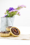 Chocolate tart and a vase of flower Stock Images