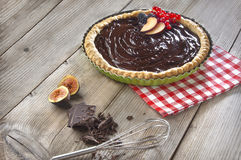 Chocolate tart on a wooden table Stock Images