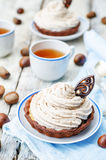 Chocolate tartlet with chestnut cream frosting Royalty Free Stock Photo