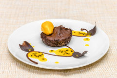 Chocolate tartlet with mousse and sorbet. Chocolate tartlet with mango mousse and mango sorbet Stock Image