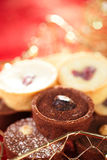 Chocolate tartlets in festive golden red style Stock Photos