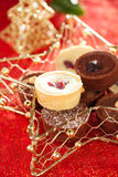 Chocolate tartlets in festive golden red style Stock Photo