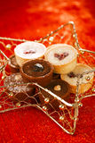 Chocolate tartlets in festive golden red style Stock Photography
