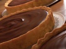 Chocolate tarts. Three self-indulgent rich desserts Royalty Free Stock Photos
