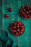 Chocolate tarts with fresh sweet cherry Stock Photography