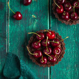 Chocolate tarts with fresh sweet cherry Stock Photo