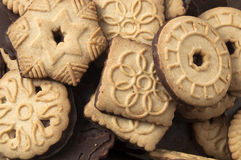 Chocolate tea biscuits. Delicious chocolate tea biscuits in different shapes and decorated with interesting ornaments and symbols royalty free stock photos