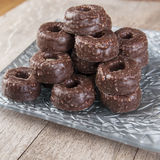 Chocolate tea biscuits on wooden table. Close up photo Stock Images