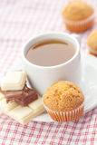 Chocolate,tea and muffin on plaid fabric Royalty Free Stock Photos