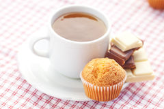 Chocolate,tea and muffin on plaid fabric Stock Photography